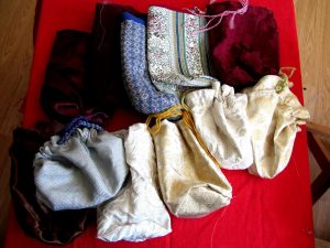 Cloth pouches, by Baroness Lucia de Enzinas.